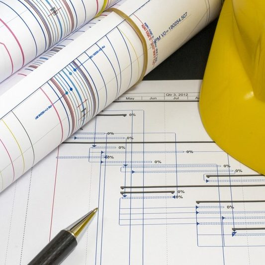 Blueprints with yellow hard hat