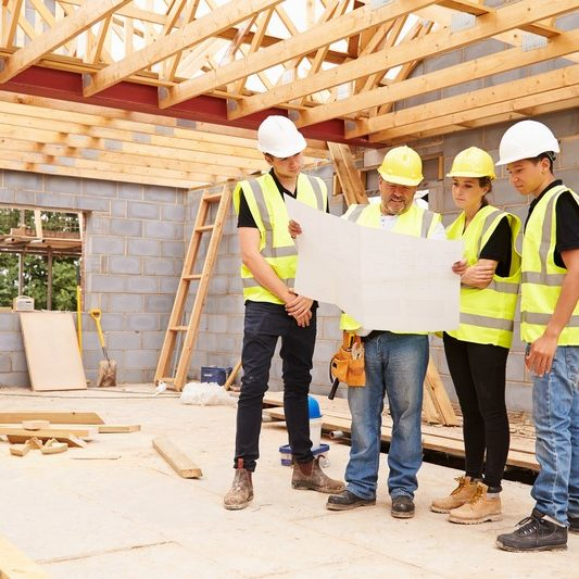 Team on site under wood trusses